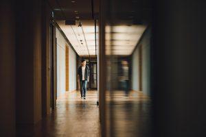 Boy Walking down school hall